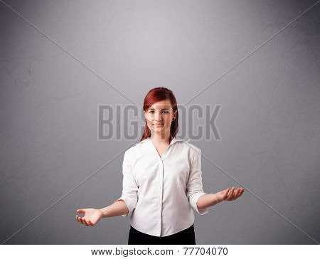 beautiful young lady standing and juggling with copy space