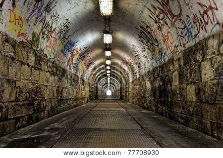 Dark undergorund passage with light