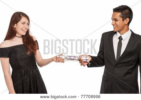 Young Couple Pulling A Xmas Cracker.