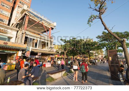 TAIPEI, TAIWAN - November 21th : Many tourists stroll in the side of the trail Tamsui, Taipei, Taiwan on November 21th, 2014.