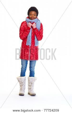 Beautiful african girl in winter coat isolated white background