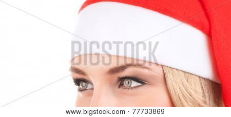 Closeup portrait of cute woman wearing red Santa hat isolated on white background, half face of girl with beautiful eyes, Christmas holidays concept