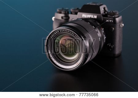 BERLIN, GERMANY - OCT. 25, 2014:Fujifilm X-T1 Mirrorless Digital Camera on black background.