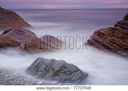 Big stones in the sea at sunrise