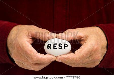 Man Holds White Nest Egg With RESP Written On It