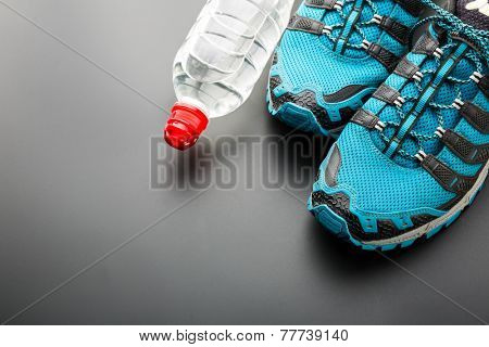 Sports runners and a bottle of water