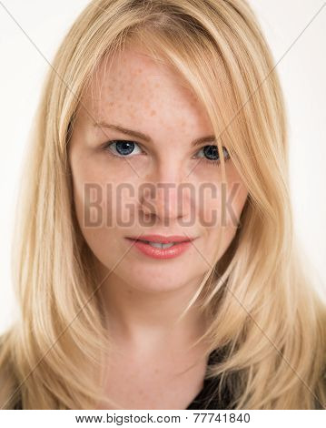 Gorgeous Blond Woman With Freckles Against A White Background
