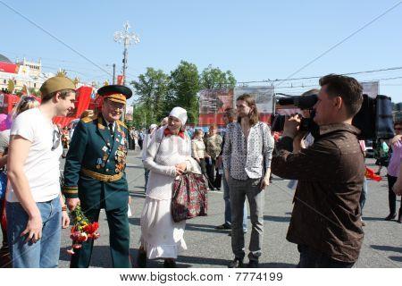 Young man congratulate the Veteran of War