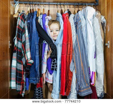 Cute Little Girl Hiding Inside Wardrobe From Her Parents