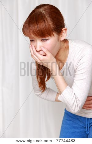 vomiting young Japanese woman