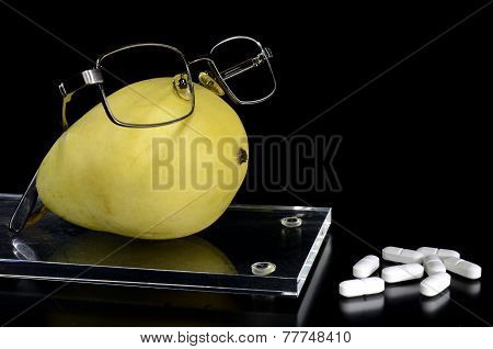 Spectacled Pear On A Tray And Pills