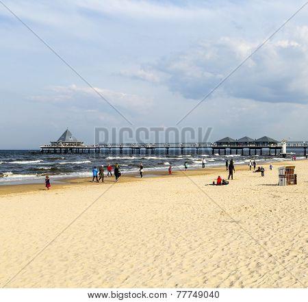 People Enjoy Pier And Beach Of Heringsdorf