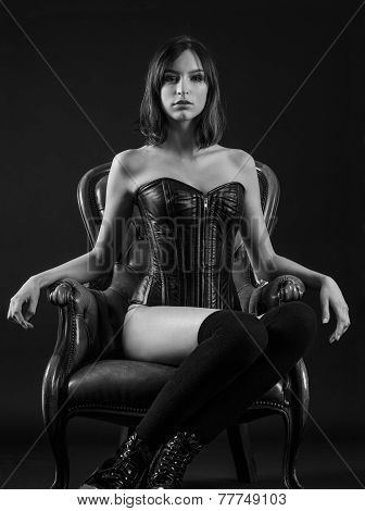 Beautiful Woman Sitting Wearing A Corset