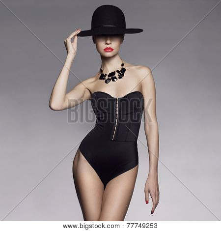 Fashion photo of beautiful lady in elegant black hat