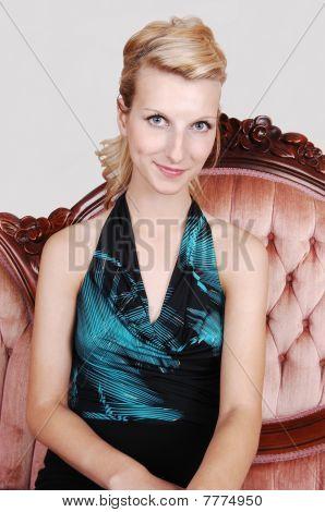 Beautiful Girl Sitting On A Sofa.