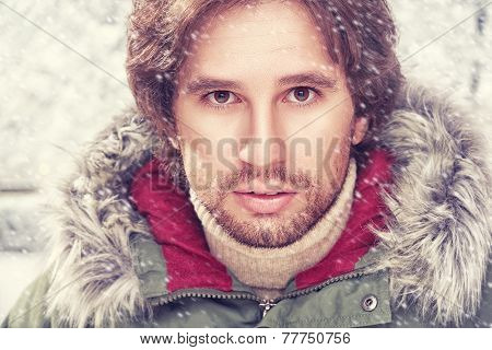 brutal face of man with beard bristles winter