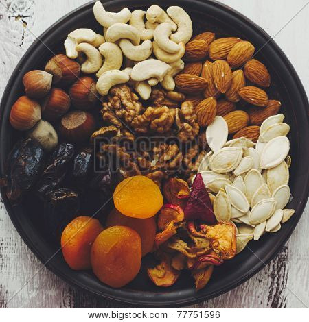 Variety of 8 assorted nuts and dried fruits, top view