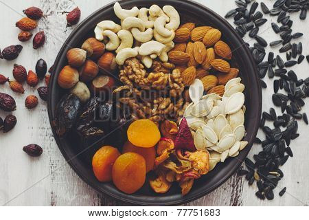 Variety of 12 assorted nuts and dried fruits, top view
