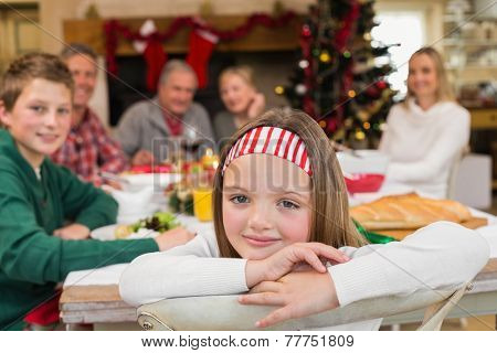 Portrait of smiling daughter during christmas dinner at home in the living room