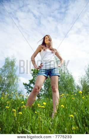 Teen Standing  In Dandelion Meadow
