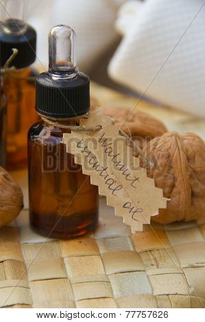 Walnut essential oil in a dropper bottle.