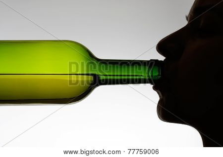 Woman Drinking From A Bottle