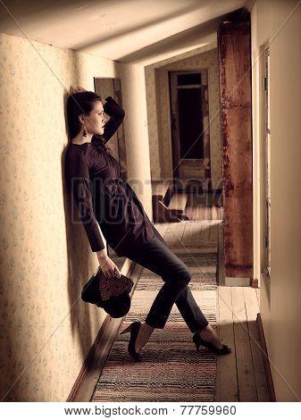 Fashionable Girl And Retro Corridor