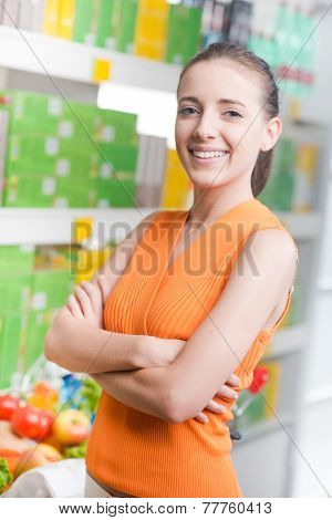 Female Customer Smiling At Supermarket