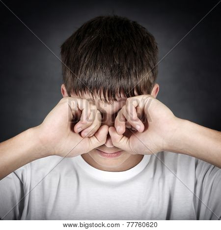 Young Man Rub The Eyes