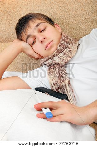 Sick Teenager With Thermometer