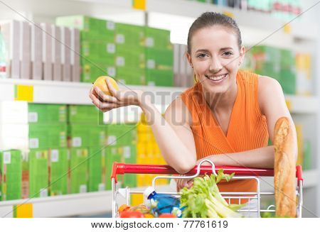 Woman Buying Fruit At Store