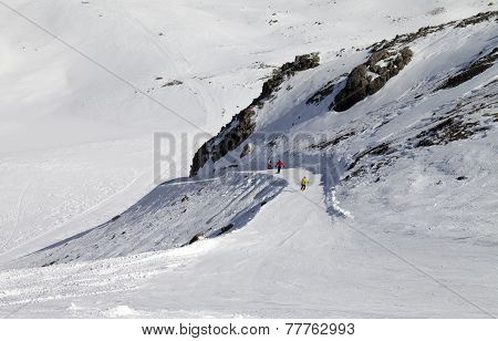 Snowboarders And Skiers On Ski Slope