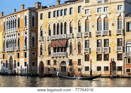 Gondolier Floats Past The Old Palazzo In Venice