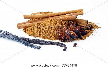 Cinnamon Sticks, Ground Cinnamon, Vanilla Pods And A Star Anise