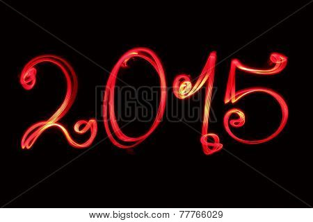 Happy new year greeting 2015 written by red light