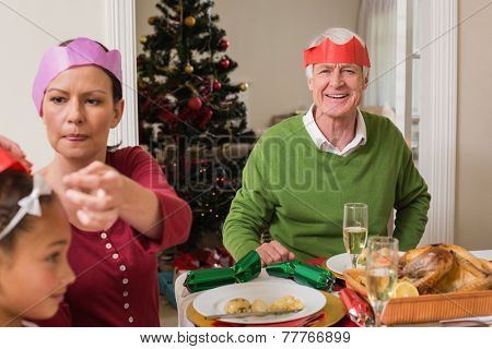 Family in party at christmas dinner at home in the living room