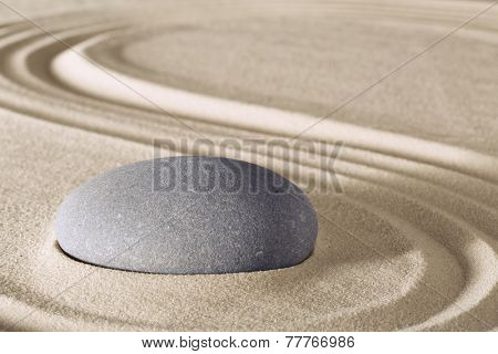 Zen meditation stone traditional Japanese garden with sand and rock pattern spa wellness in simplicity harmony and serenity helps in concentration and relaxation