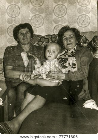 GERMANY, CIRCA FIFTIES: Vintage photo of grandmothers with their grandchild