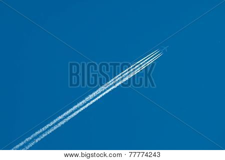 Flying plane and inversion trace from engines