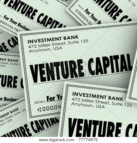 Venture Capital words on checks to illustrate money or financial investment in a new business or company to grow and achieve success