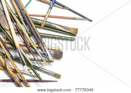 Pile Of Thrown Down Old Brushes, Isolated On White