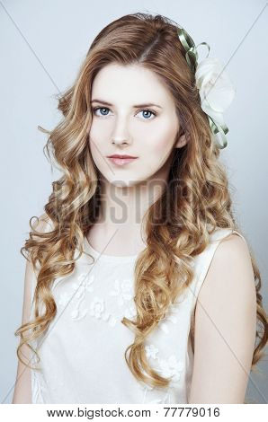 Tender Young Woman With Long Curtly Blond Hair