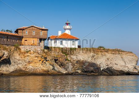 Lighthouse And Wooden Buildings On St. Anastasia Island
