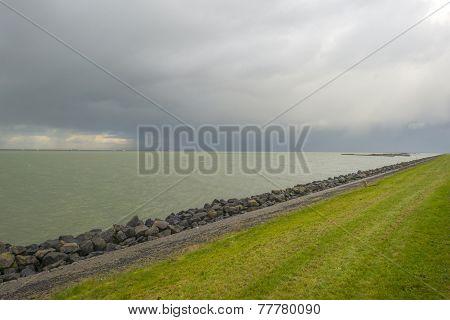 Basalt stones along a lake protecting a dike