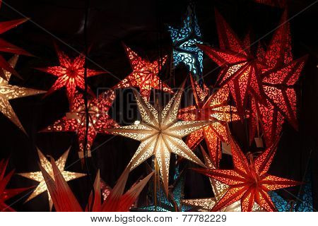 Paper christmas stars on a dark background