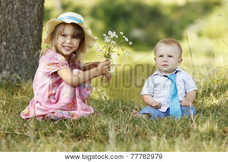 Little Brother And Sister Playing On The Nature