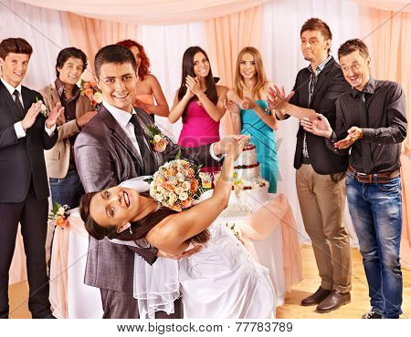 Happy group people at wedding dance.