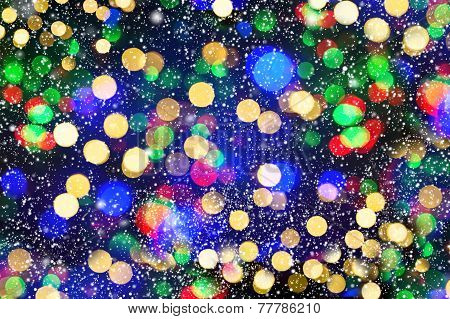 Defocused Lights With Snowfall Effect. Winter Night. Abstract Background