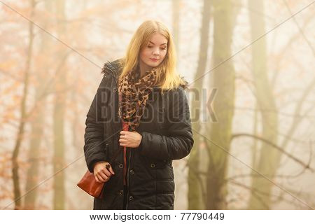 Woman Walking In Park In Foggy Day