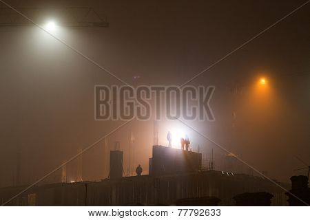 Construction Site At Night In The Fog